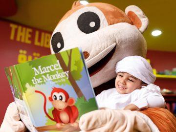 An Arab Kid Enjoying A Story Telling Session