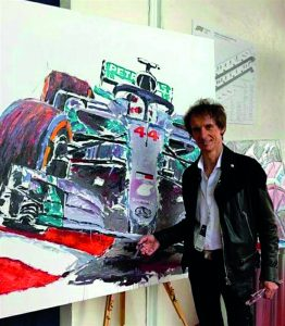Artist Armin Flossdorf alongside one of his artworks