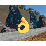 A Wall painted with murals showing women wearing burqa and handcrafting baskets