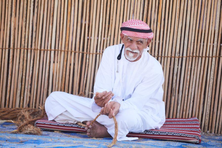 Emirati man with traditional handcraft work