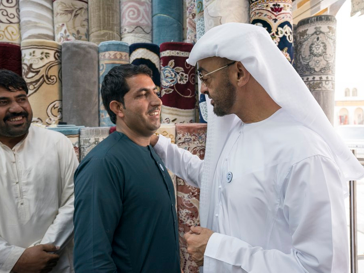 H.H. Sheikh Mohamed bin Zayed at the carpet market in Al Mina.